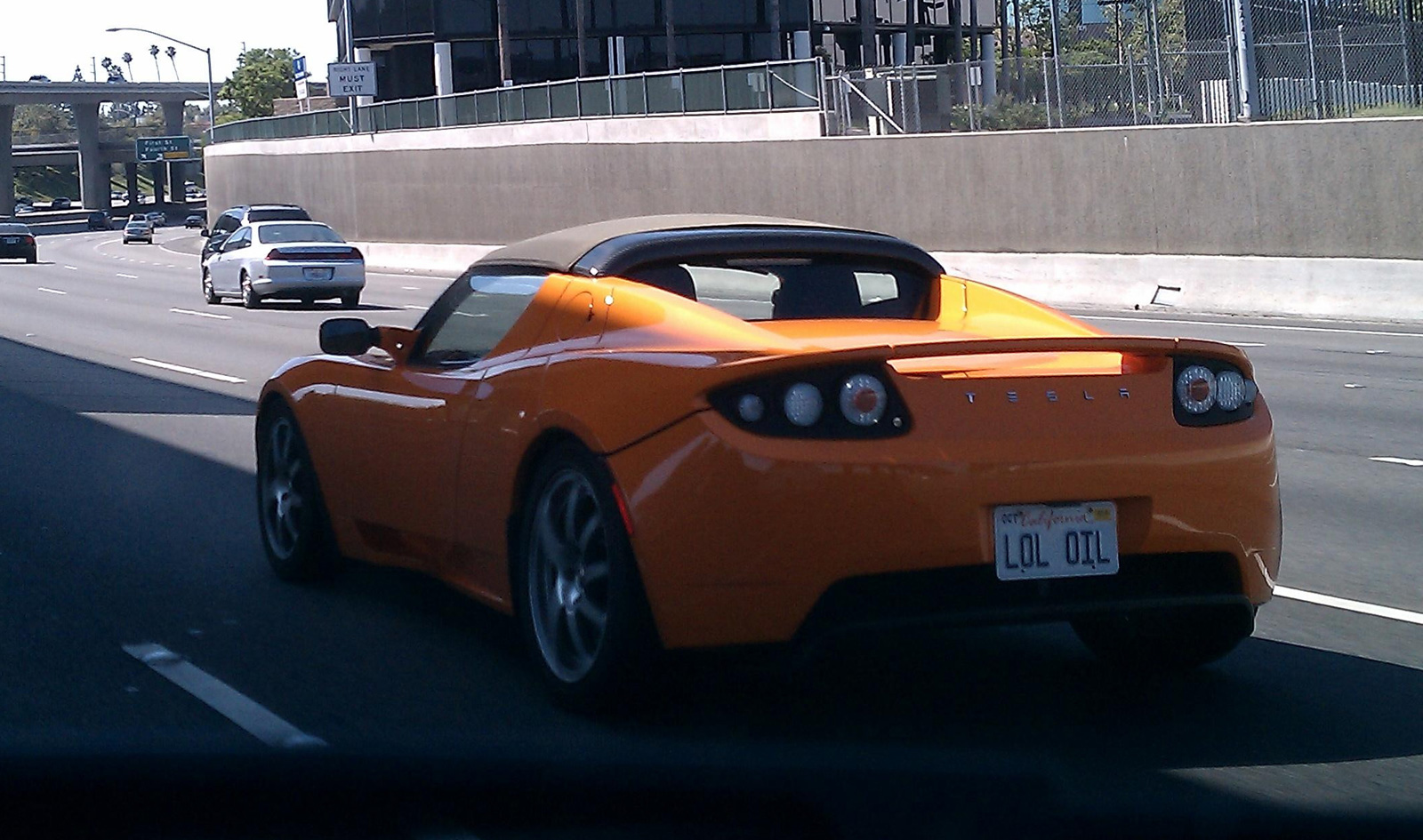 Tesla Roadster with LOL OIL License Plate