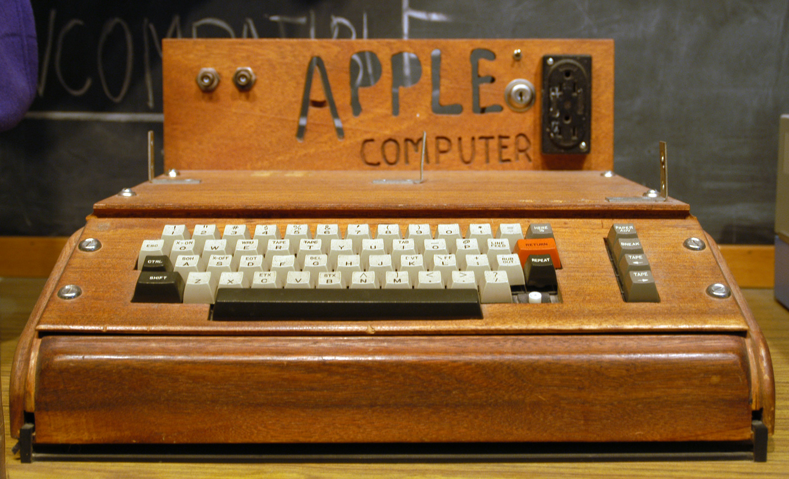 The Apple-1 Computer customised with an after-market wooden enclosure with carved name and keyboard