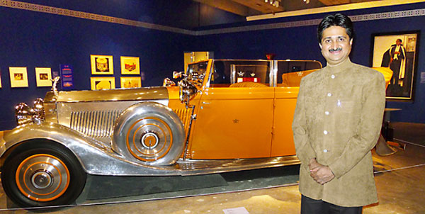 Maharaja-YS-Mandhatasinhji-of-Rajkot-poses-with-Star-of-India-Rolls-Royce-1