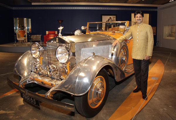 Maharaja YS Mandhatasinhji of Rajkot poses with Star of India Rolls Royce
