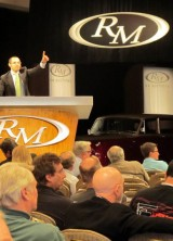 RM Auctioneer, Max Girardo, calling his bid