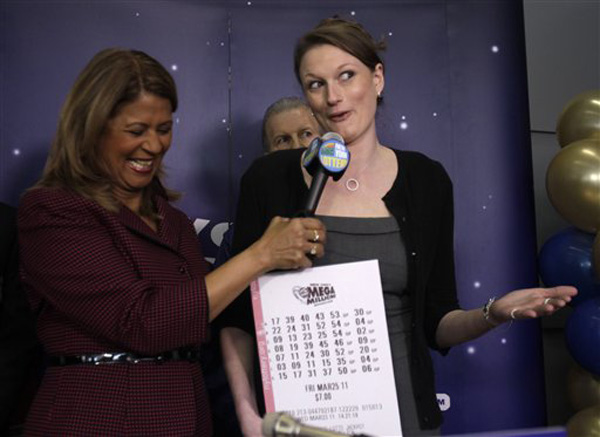 Gabrielle Mahar, right, who shared in the $319 million Mega Millions lottery win
