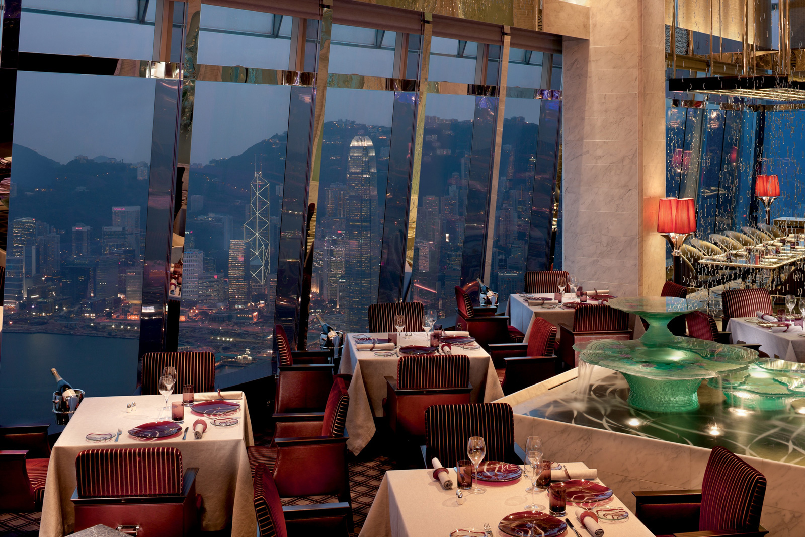 Restaurant with evening view of habor and city at The Ritz-Carlton, Hong Kong