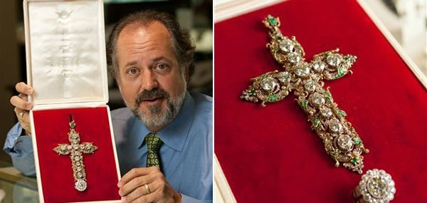 Alan Perry, owner of jewelry store Perry's Emporium, displays the papal jewelry