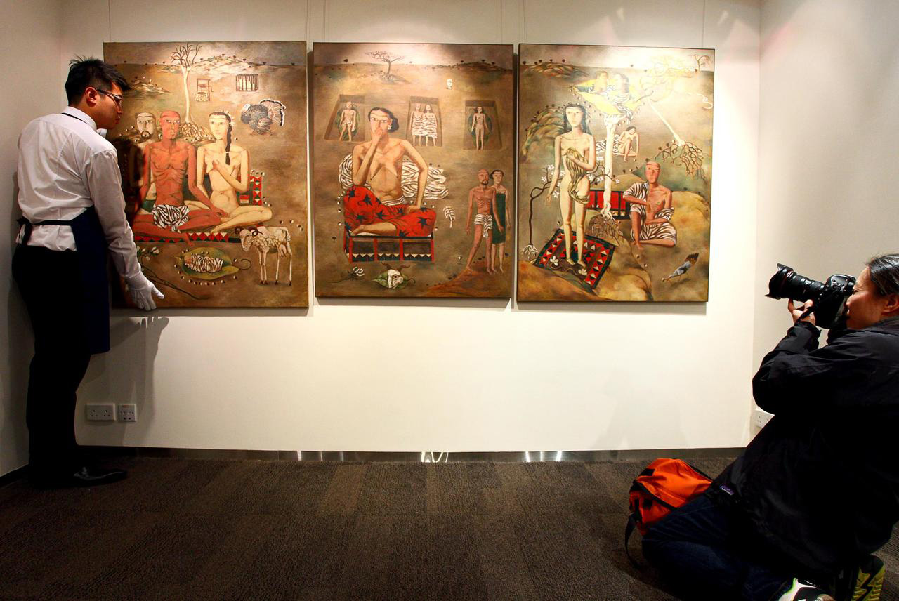 A triptych oil painting by Chinese artist Zhang Xiaogang sold for $10.1 million