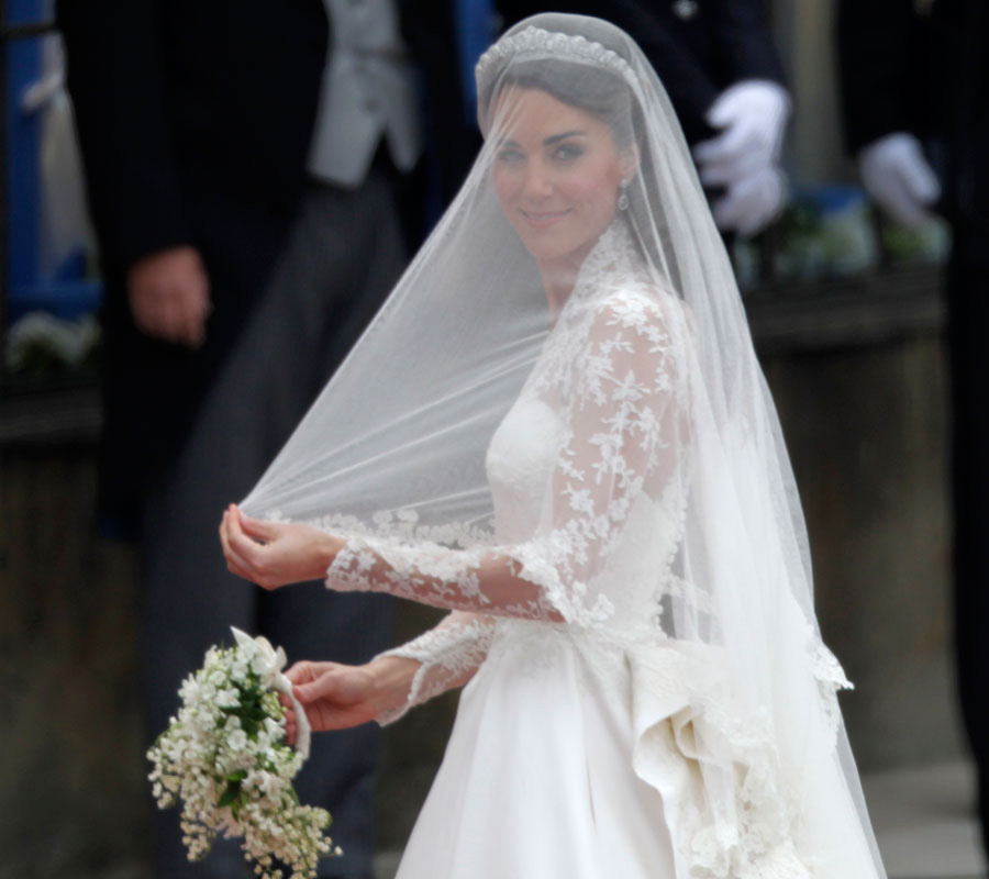Kate Middleton's wedding dress is an ivory gown with lace applique floral detail designed by Sarah Burton at Alexander McQueen