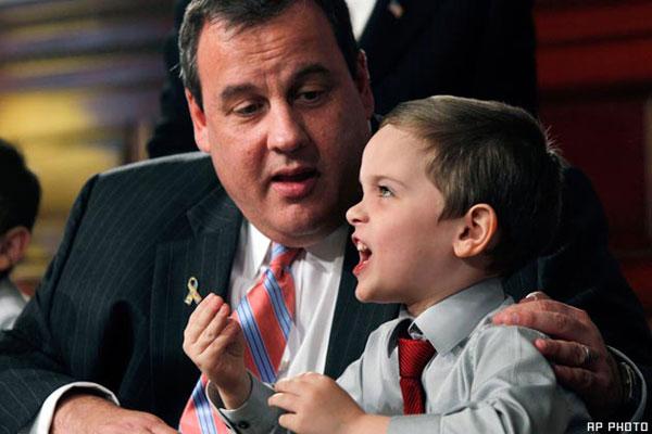 New Jersey Gov. Chris Christie listens to 5-year-old Jesse Koczon