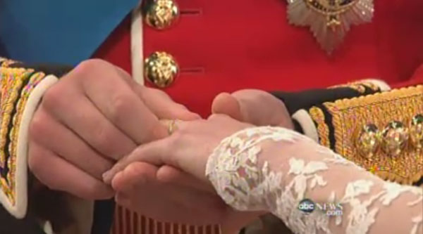 Prince William puts the ring on Kate Middleton's finger