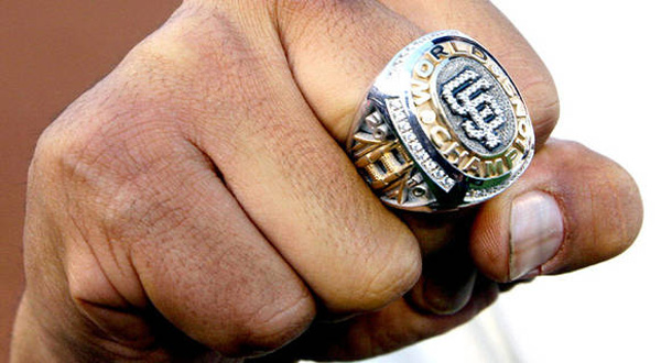 Giants pitcher Sergio Romo shows off his 2010 World Series championship ring.