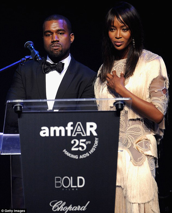 Kanye joined supermodel Naomi Campbell on stage at the amfAR's Cinema Against AIDS Gala to raise awareness for the cause