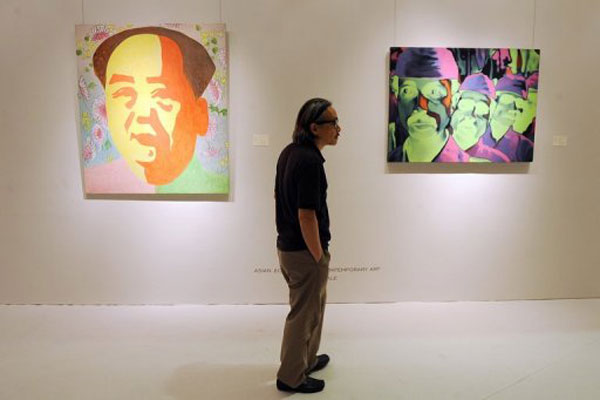 Visitors look at artwork at an auction preview in Hong Kong (AFP, Mike Clarke)