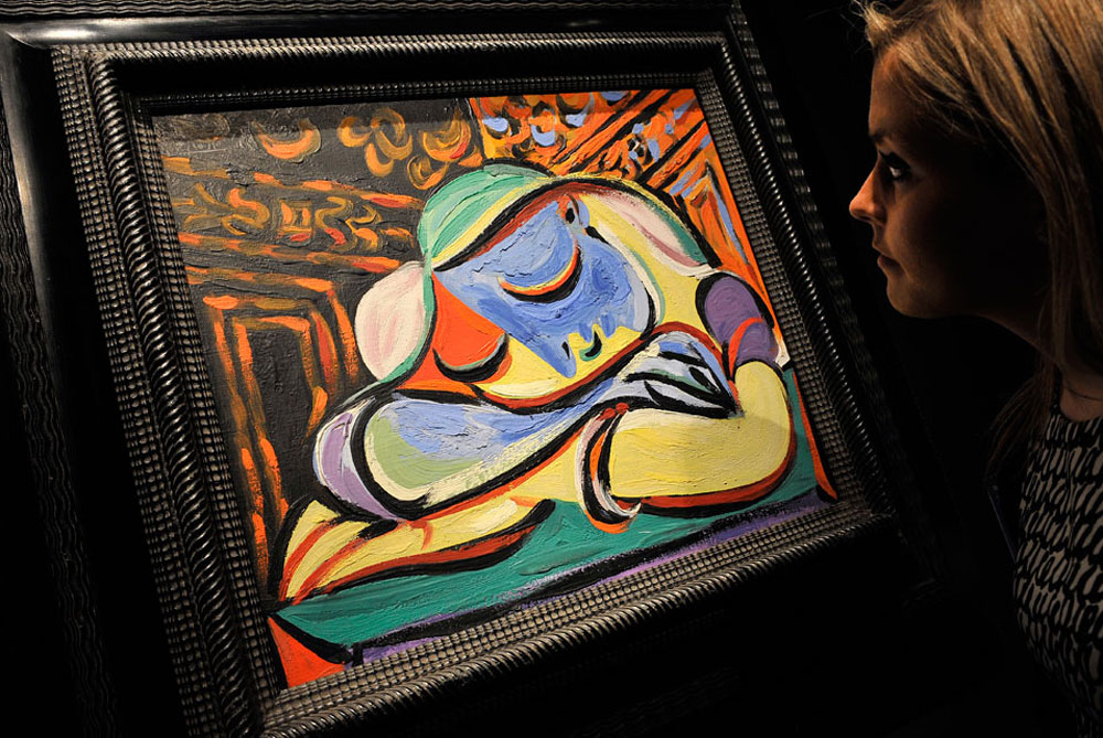 A Christie's Auction House staff looks over Pablo Picasso's rarely seen Jeune Fille Endormie