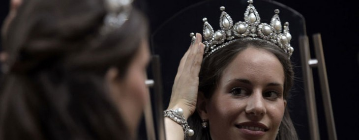 A Christie's auction house employee poses with a Rosebery Pearl and Diamond Tiara