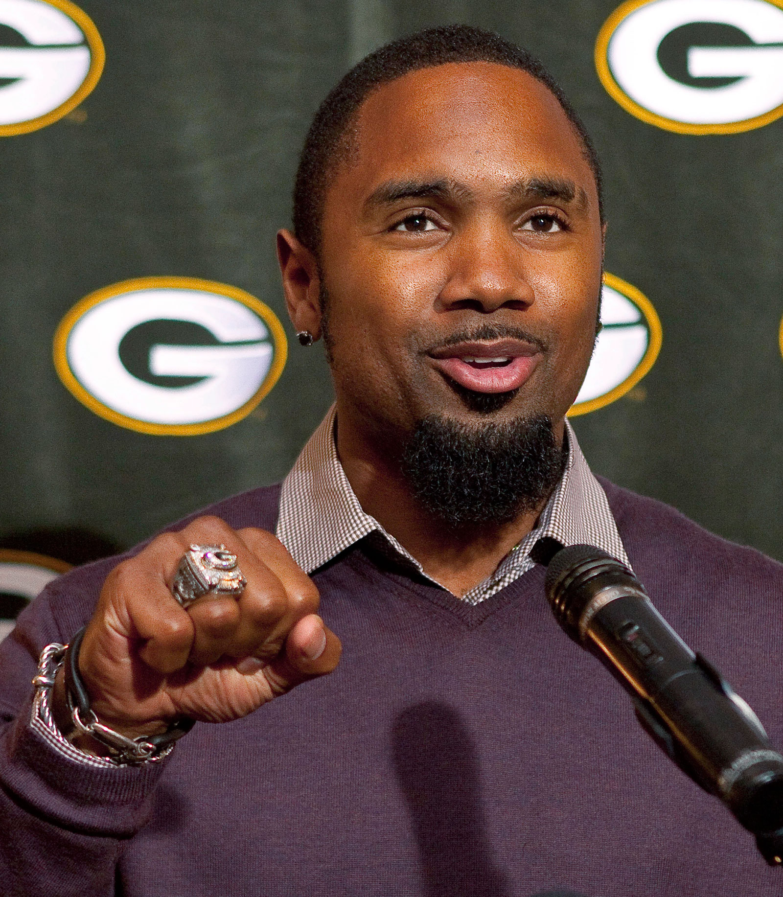 Green Bay Packers' Charles Woodson shows off his Super Bowl ring