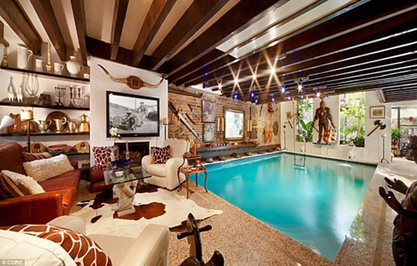 The $10 million Manhattan mansion with a 30,000 gallon swimming pool in the living room