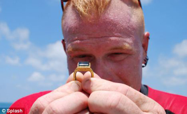 One of the divers from Mel Fisher's Treasures shows off the ring