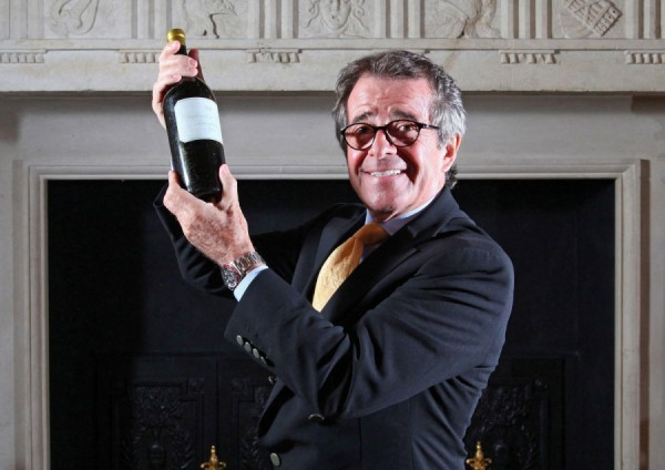 Christian Vanneque holds the bottle of 1811 Chateau d'Yquem