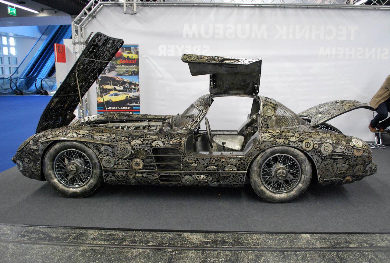 Giants of steel turns scrap metal into german classics for Mercedes benz scrap yard