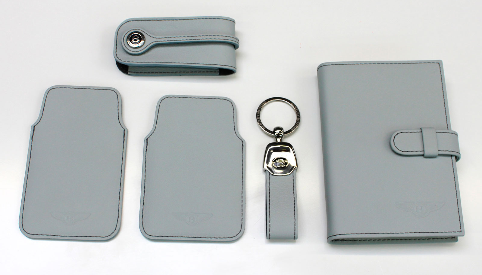 Bentley Collection in Breeze (Clockwise from top: Key Case, Notebook, Loop Keyring, Blackberry Case and iPhone Case)