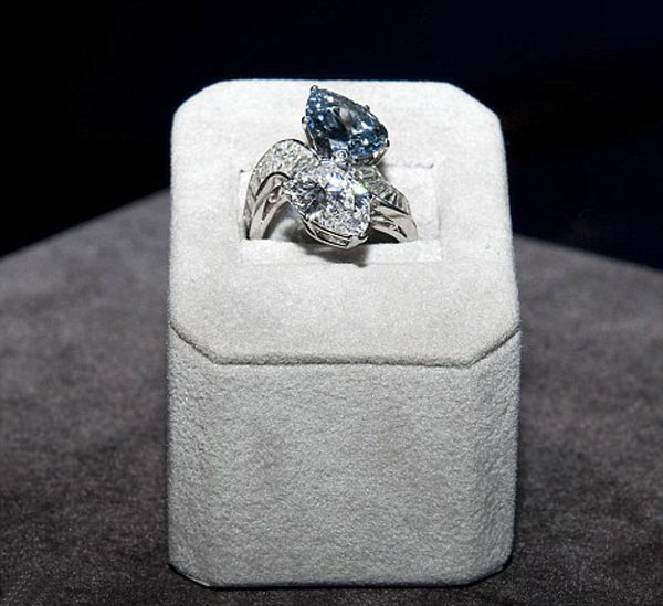 Diamond and Blue Diamond Crossover Ring made by Bulgari