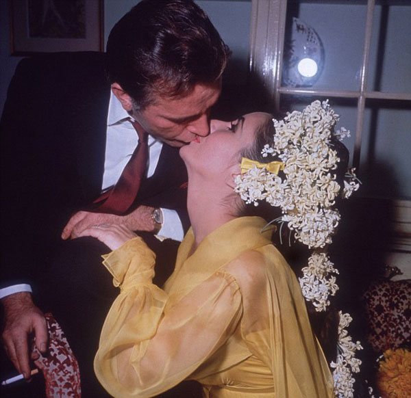 Elizabeth Taylor with Richard Burton on their first wedding day in 1964