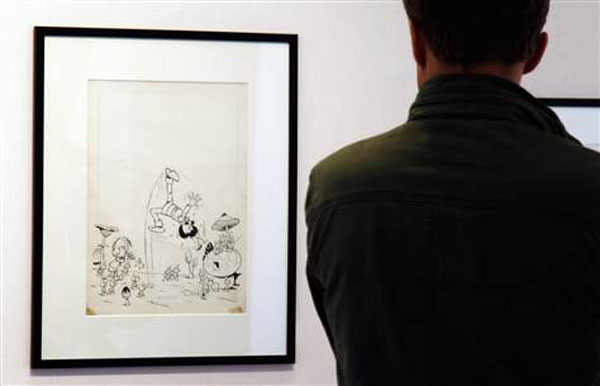 "A visitor looks at ""The Smurfs and the Magic Flute,"" expected to be the highlight of an upcoming art auction"