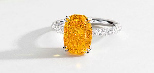 Fancy Vivid Orange Diamond and Diamond Ring