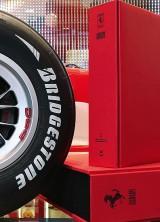 Nigel Mansell Signs The Official Ferrari Opus