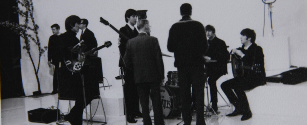 Never-before-seen black-and-white photographs taken of the Beatles during their early years are going on the auction block