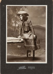 Previously unknown and unpublished Annie Oakley as The Western Girl, a Rare Cabinet Photo Signed and Inscribed on Verso