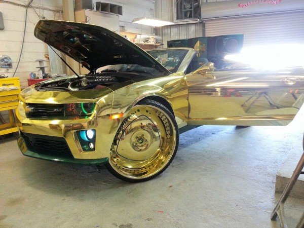 Gold-soaked King ZL1 Camaro rides on 30-inch gilded wheels with three 23-inch TVs