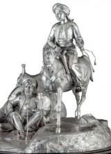 A MONUMENTAL GARRARD VICTORIAN SILVER FIGURAL CENTERPIECE