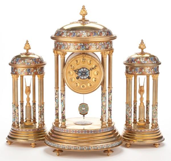 A THREE PIECE FRENCH GILT BRONZE, CLOISONNÉ AND CHAMPLEVÉ ENAMEL CLOCK GARNITURE