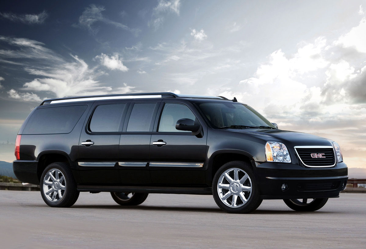 lexani motorcars showcases gmc yukon xl conversion coach extravaganzi. Black Bedroom Furniture Sets. Home Design Ideas
