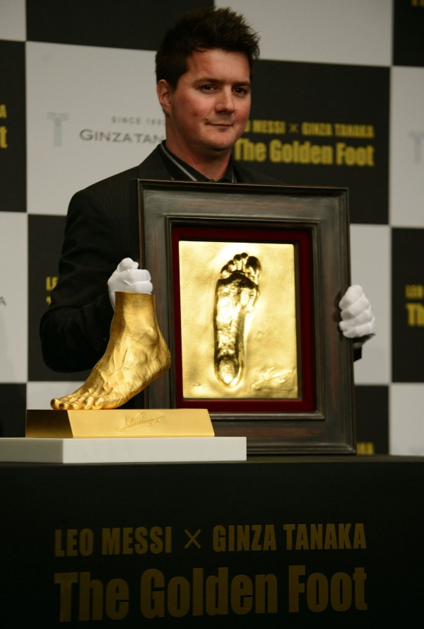 Rodrigo Messi, brother of football star Lionel Messi of Argentina, with Messi's Left Foot Gold Sculpture