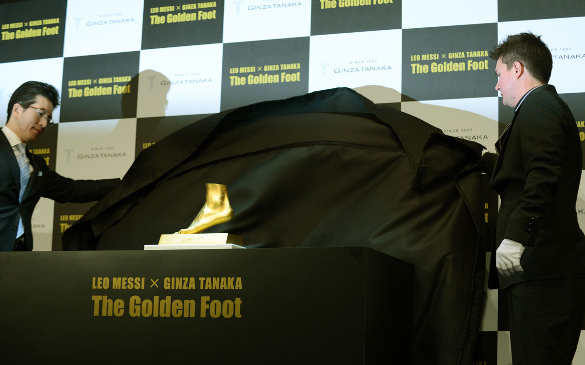 Rodrigo Messi, brother of football star Lionel Messi of Argentine (R) and Ginza Tanaka President Masakazu Tanaka (L) unveil the golden replica of Lionel Messi's left foot