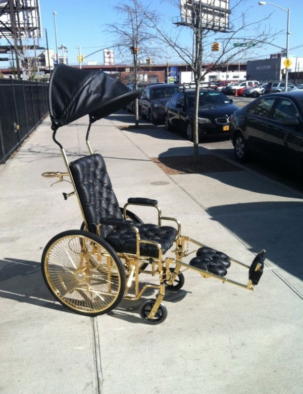 The chair features gold plated metal, even down to the brakes