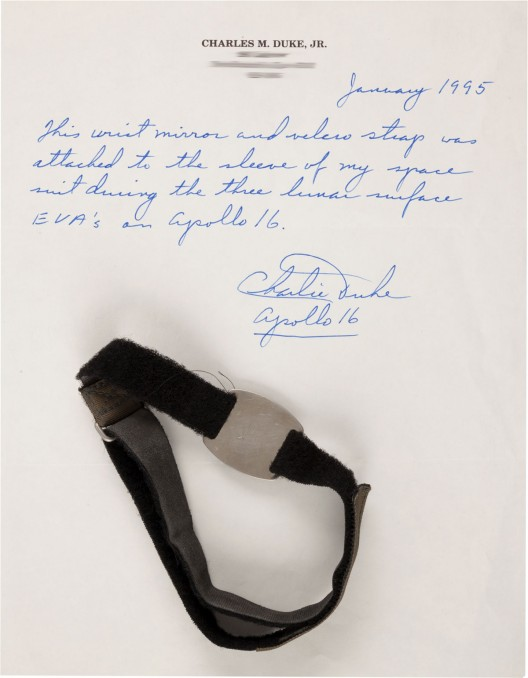 Apollo 16 Lunar Module Flown and Surface-Used Wrist Mirror with Watch Strap Originally from the Personal Collection of Mission Lunar Module Pilot Charlie Duke, with Signed Photo and LOA