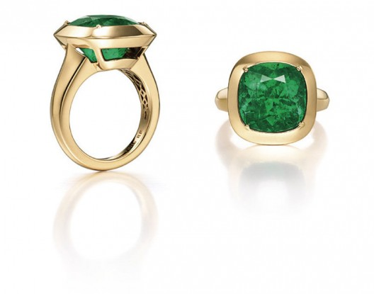 A cushion-shaped emerald ring designed by Angelina Jolie along with Robert Procop