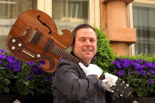 Darren Julien, president of Julien's Auctions, with the VOX guitar