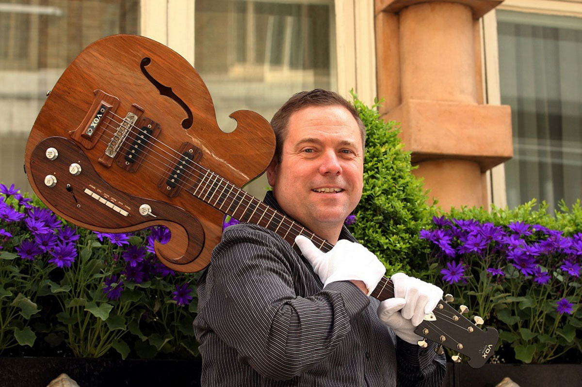 Darren Julien President Of Juliens Auctions With The VOX Guitar