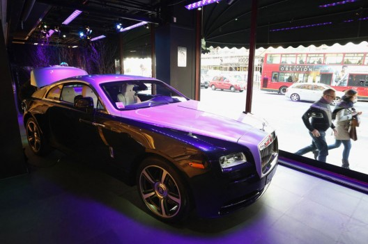 A new Rolls-Royce Wraith coupé car is displayed in a window of Harrods department store in Knightsbridge, London, England