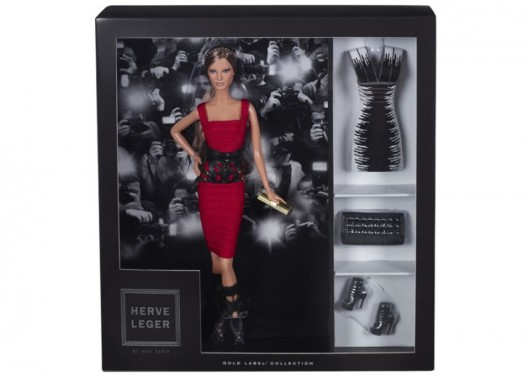 Hervé Léger by Max Azria Barbie Doll stands tall in bandage dress