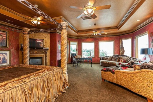 For sale in Texas, a stately Mediterranean luxury home with Louis Vuitton branded bedroom