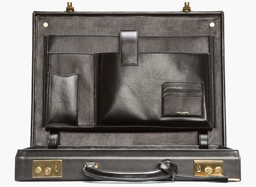 Black leather hardshell briefcase with gold tone