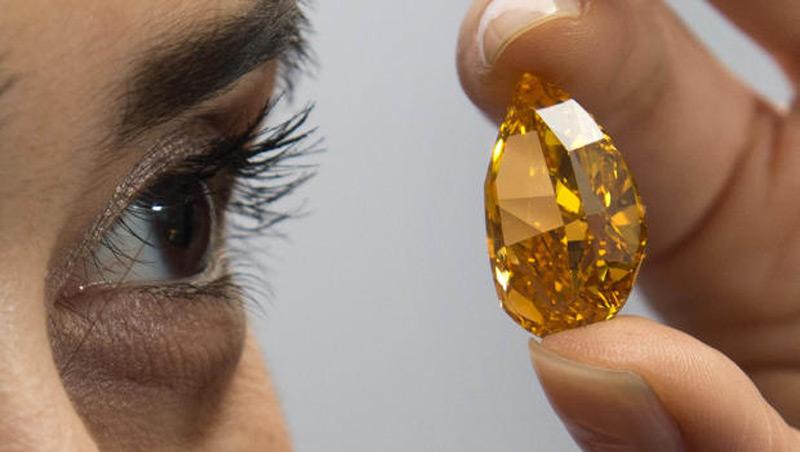 A 14.82 carat Orange Diamond sells for a record shattering $35.5 million