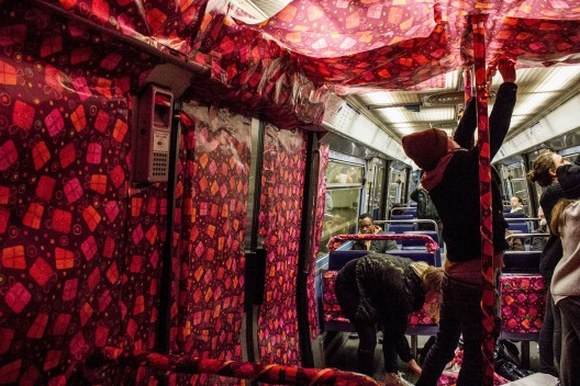 In Paris, A Metro Train Covered In Gift Wrap Brings Festive Cheer To Commuters