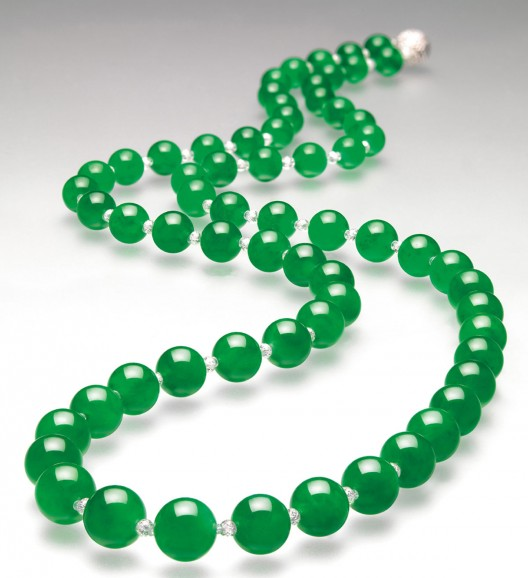 The Hutton-Mdivani Necklace, comprised of 27 enormous Qing jadeite beads with an Art Deco ruby and diamond clasp by Cartier