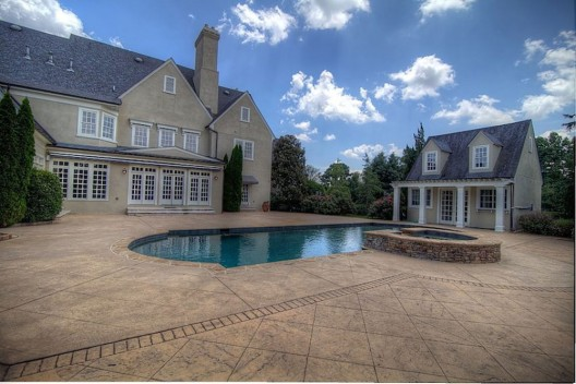 Gated French country estate, Chateau Tivoli, is an extraordinary 10 acre property located in the heart of Roswell.