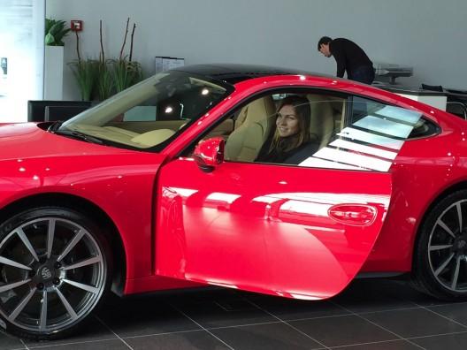 twenty three year-old player is also richer for the new red Porsche 911 Carrera 4